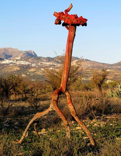 Warzenköpfiger Unhold', Mandel- und Pappelholz, Fundort Andalusien, mit Grün, Rot und Braun koloriert.