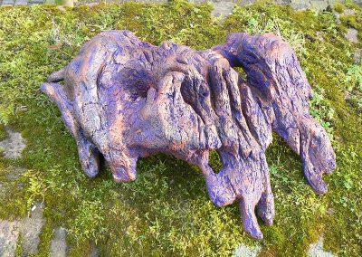 Muskulöser Prachtläufer'. Eichenwurzel. Mit Kupfer, Bronze, Violett, Gold koloriert. Fundort Westerwald.